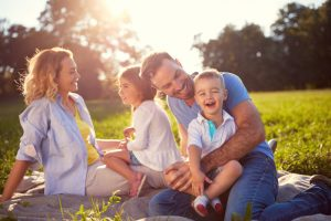 Happy family in sunshine